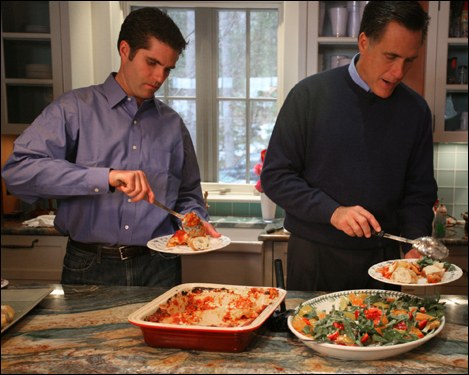 Tagg Romney (left) and Governor Mitt Romney at their NH lake house on April 15, 2007. The entire Romney family (all 22 of them) were together at the house to celebrate Ann Romney's 58th birthday. Tagg and Mitt serve lasagna and salad for lunch.