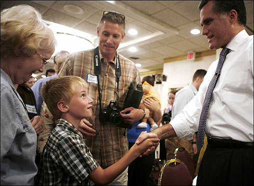 Romney greeted voters during an 'Ask Mitt Anything' meeting at the Best Western Midway Hotel on June 16 in Dubuque, Iowa. Romney told hundreds of antiabortion activists on May 15 that his conversion to their cause is genuine as he sought to fend off rivals' criticism that he has been inconsistent on the issue.
