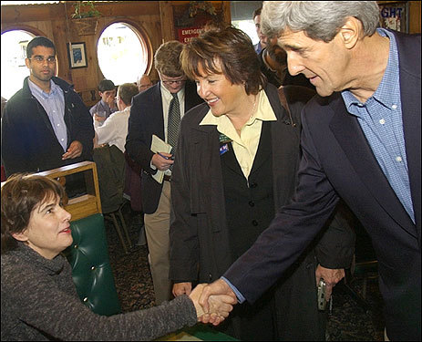 Larsen (center, with Senator John Kerry) has been a leading player in New Hampshire Democratic politics for the past 15 years and her ascension to Senate President this year shows she is on her way up. Larsen endorsed Hillary Clinton for president.