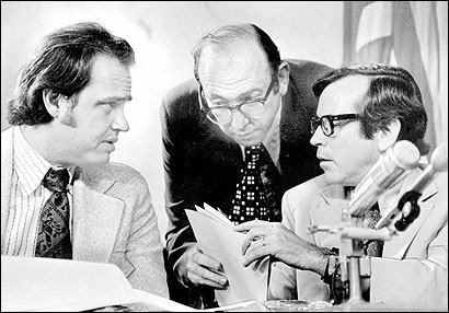 The Senate Watergate Committee chief counsel, Samuel Dash, crouched to confer with Fred Thompson (left) minority counsel, and Senator Howard Baker during a July 1973 hearing.