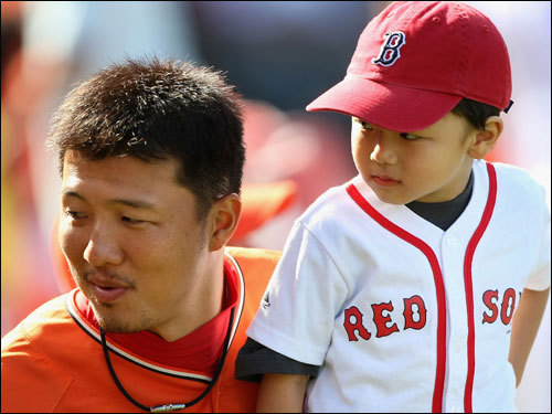 Hideki Okajima of the Red Sox and his son attend the All-Star Home Run Derby at AT&T Park on Monday in San Francisco.
