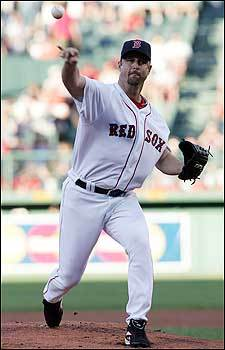 Tim Wakefield delivers for the Red Sox during the first inning. Wakefield gave up four runs on 11 hits and two home runs in his six innings of work.