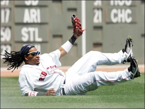 Manny Ramirez makes a diving catch on a Reed Johnson line drive in the first inning.