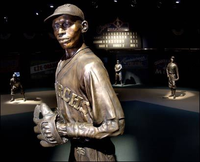 A bronze likeness of pitching great Satchel Paige at the Negro Leagues Baseball Museum in Kansas City, Mo. The Country Club Plaza, designed in 1922 as the nation's first suburban shopping district, includes an open-air public art gallery among its patterned Spanish Revival buildings.