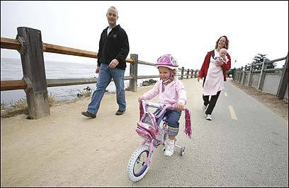 Erik and Katie Eldridge and their daughters Hope, 3, and Faith, 4 months, enjoy the Monterey Bay Coastal Recreation Trail.