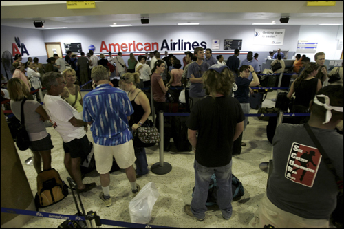 Tourists waited in line for a flight out from Belize as Hurricane Dean approached on Monday.
