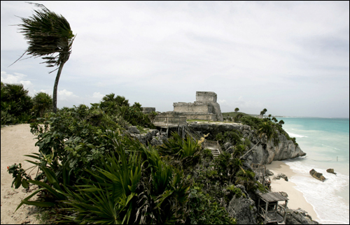 Thousands of tourists fled the beaches of the Mayan Riviera as it roared toward the ancient ruins and modern oil installations of the Yucatan Peninsula. At left, a view of the ruins of Tulum.
