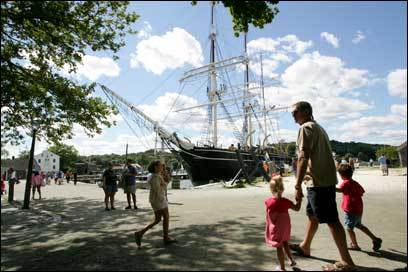 Tourists flock to Mystic Seaport for a look at historic vessels and tall ships, like the Charles W. Morgan.