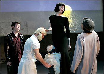 Jennifer Baldwin Peden (center) is Elvire in 'Don Juan Giovanni,' Theatre de la Jeune Lune's adaptation of Moliere's 'Don Juan' and Mozart's 'Don Giovanni.'