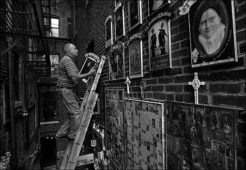 NORTH END -- In an alley between 4 and 8 Battery Street, Peter Baldassari works on his labor of love. Arrayed on the brick walls are thousands of images of saints. Baldassari, 63, says his passion for the saints began in childhood when he accumulated a shoebox of holy cards. Now people come from all over the world to visit All Saints Way and to give him new images. 'Visitors have never seen anything like this,' he says. One of the most recent image he hung was that of Elizabeth Ann Seton, 1774-1821, who started the first American parochial school and who, in 1975, was the first native-born American to be canonized. On the wall along with the saints, Baldassari has posted an old Italian saying: 'Mock all and sundry things, but leave the saints alone.' (Photo and Audio by Suzanne Kreiter, Globe Staff) audio: Peter Baldassari talks about his shrine to the saints <object classid='clsid:02BF25D5-8C17-4B23-BC80-D3488ABDDC6B' width='200' height='30' codebase= 'http://www.apple.com/qtactivex/qtplugin.cab'>