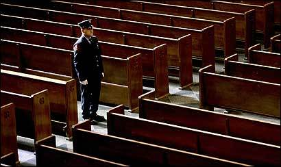 A firefighter stood at attention during the wake for firefighter Paul J. Cahill yesterday at Holy Name Church in West Roxbury. A funeral Mass will be held today.