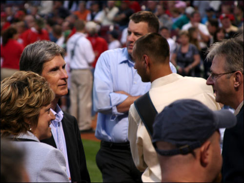 Red Sox owner John Henry (left) and Red Sox Foundation executive director Meg Vaillancourt spoke with Rick Arrowood (far right), president of The ALS Association's Massachusetts chapter prior to pregame ceremonies.