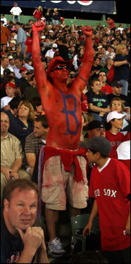 Jack Driscoll, from Londonderry, N.H., was painted in red because 'it's Red Sox-Yankees.'