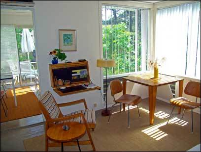 At The Colony of Wellfleet, vintage Eames table and chairs sit inside unit 9A.