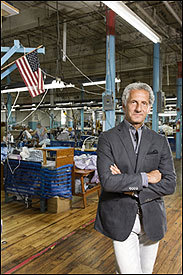 Designer Joseph Abboud in his newly acquired Fall River factory where workers turn out high-end dress shirts.
