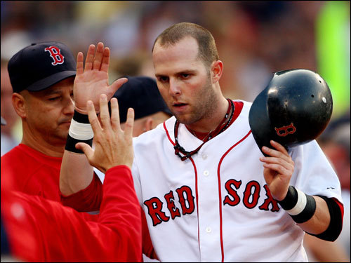 Dustin Pedroia was congratulated for scoring a run after a single by teammate Mike Lowell in the third inning on Wednesday.