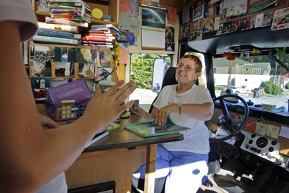 Inside the Beverly Library 'Bookmobile' Linda Caravaggio (right) chats with a customer.