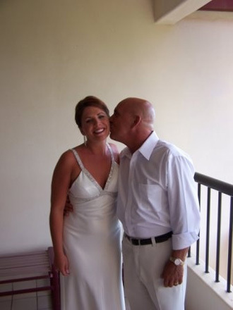 My Dad giving my a kiss before the wedding on the deck of my hotel room
