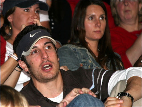 Actor Jason Biggs, who is co-starring with Dane Cook in the movie 'Bachelor No. 2,' being filmed in Boston, witnessed Josh Beckett's shutout from behind the plate. Behind him (upper right) is Tiffany Ortiz, the wife of Mr. October.