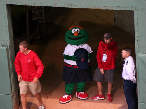 Ubiquitous Red Sox mascot Wally the Green Monster gets ready for the pregame introductions under the left field stands at Fenway Park.