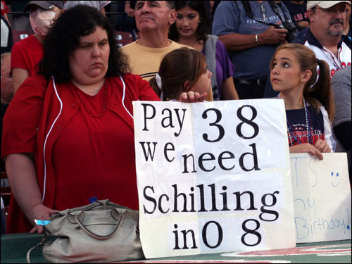 Kristen Byrnes from Newton held a sign in support of re-signing Curt Schilling for another season. 'Give him the $13 million,' Byrnes said even though Schilling finished the season with just nine wins.