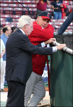Angels manager Mike Scioscia (right) had a long chat with hall-of-fame baseball writer Peter Gammons as the Angels finished up batting practice before Game 1.