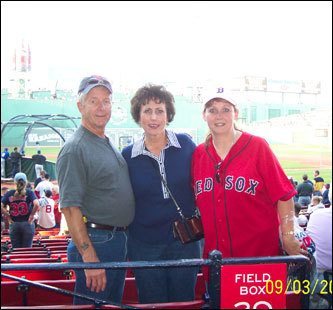 Nick, June, and Teann of Fort Worth, Texas, watch the game at Fenway.