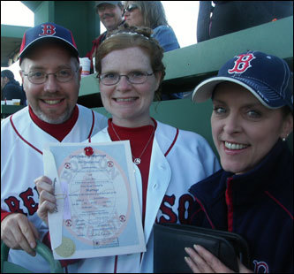 "New York couple Annette Achilles and Larry Rine wed on the Green Monster at Fenway Park during the seventh-inning stretch at the last game of the regular season. The couple wore Red Sox shirts with ""Mr."" and ""Mrs."" stitched on the back, while the bride carried a ball of red and white roses."