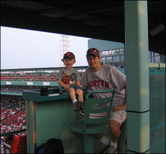 Dedham natives James (dad) and Jack enjoy a day at Fenway. Mom Kellie says James has passed on his love of the Red Sox to Jack. When asked who his favorite player is, Jack names almost every player on the team.
