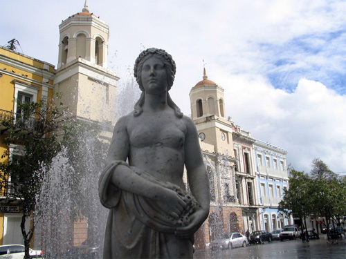 this statue had a wardrobe malfunction, but it's frickin HOT in Puerto Rico, so let the lady statues go topless, i say.