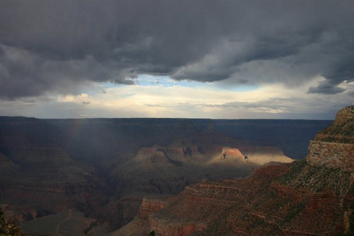 The sky opened up to reveal a light rainbow in the Grand Canyon.