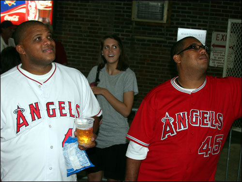 Angels starting pitcher Kelvim Escobar's brother John, from Venezuela, (right) thought his brother's outing (5 innings, 3 runs, 4 hits, 5 walks, and 5 strikeouts) was OK. Escobar's cousin Kenny, who lives in Italy, was hoping the Angels could rally for a win and go back to Anaheim with the series tied.