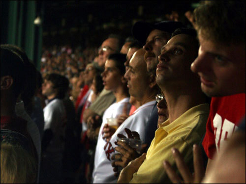 Fans in the left-field stands waited patiently for the Red Sox to break a 3-3 tie in the eighth inning.