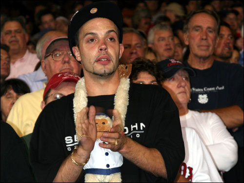 A Sox fan wears a rally monkey prior to the AL East champs coming back from a 3-2 deficit in Game 2.