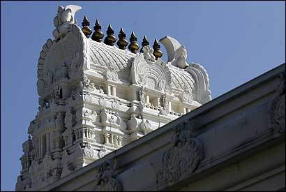 Above, the elaborate carvings of the Sri Lakshmi Temple, which is little known to the outside Ashland community.