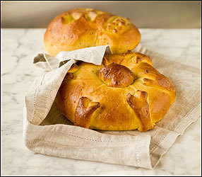 "To honor loved ones departed, pan de muerto is sometimes formed into a skull shape. More often, round loaves are decorated with ""bones"" made from extra dough."