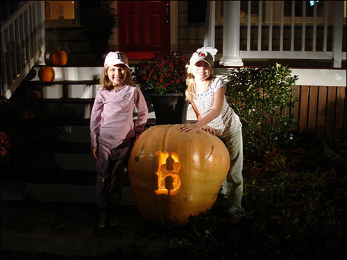 The Johnson family of Chelmsford had a huge 211-pound pumpkin, and they decided to show their Sox pride by carving a Red Sox 'B.' In the photo is 6-year-old Kendyll Johnson and her cousin Julia Enos.
