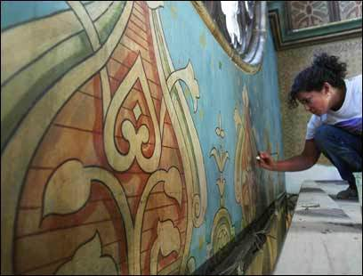 Artist Svetlana Bovrushkina updates a mural during the on-going renovation of the Eldridge Street Synagogue in the Lower East Side.