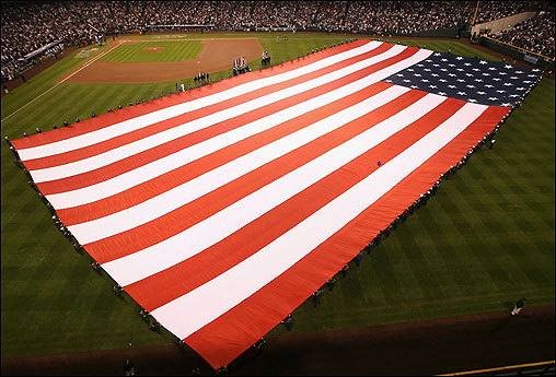 The American flag was stretched across the outfield as Yearwood sang the national anthem.