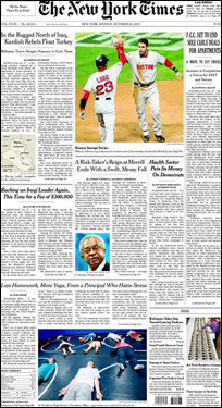 The New York Times ran a photo of Mike Lowell and shortstop Julio Lugo celebrating after Lowell scored on Jason Varitek's single in the fifth inning of Game 4.