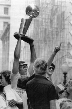 June 14, 1984: M.L. Carr held up the NBA championship trophy as Kevin McHale gave the No. 1 sign during the 'Celtics Pride Day' parade. The parade began at Park Square and ended at Boston City Hall. An estimated 250,000 people attended the celebration marking the Celtics' 15th NBA championship.