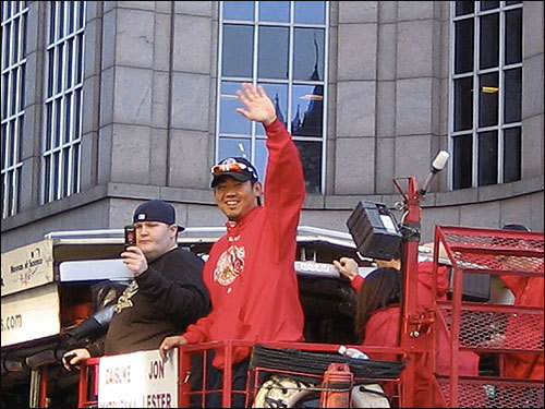 Jason Landry submitted this image of Daisuke Matsuzaka as the rolling rally headed down Boylston Street.