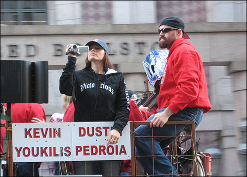 Kevin Youkilis watched the crowd, while a Bud Light case sat next to him. Maybe for Jonathan Papelbon to wear later? Submitted by James Lema.