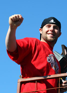 Dustin Pedroia waves to fans during the victory parade.