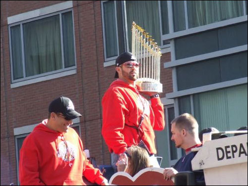 Jason Varitek held the trophy aloft for his fans. Photographed by Kerri Morey.