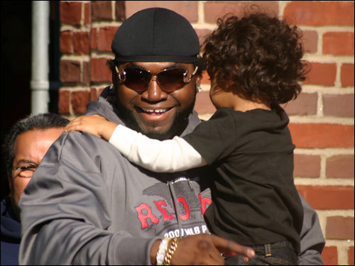 Ortiz got a nice hug from a fan, that's for sure. He was photographed by Andrew Tichovolsky.