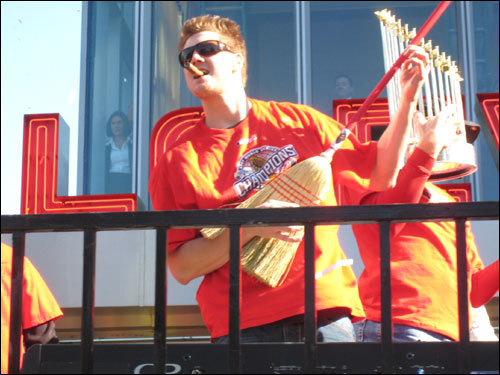 Rina Rizzi captured pitcher and entertainer Jonathan Papelbon doing his number with a broom-turned-guitar in celebration of the great Series sweep!
