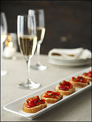 Drizzle store-bought roasted red peppers with olive oil and sherry vinegar and serve on toasted baguette rounds.