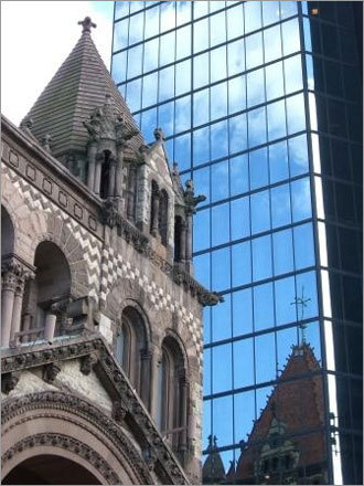 Trinity Church reflects off of the John Hancock Building in Copley Square. Submit your Boston photos