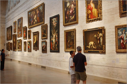 Fans regard the art adorning the walls at the Museum of Fine Art. Submit your Boston photos